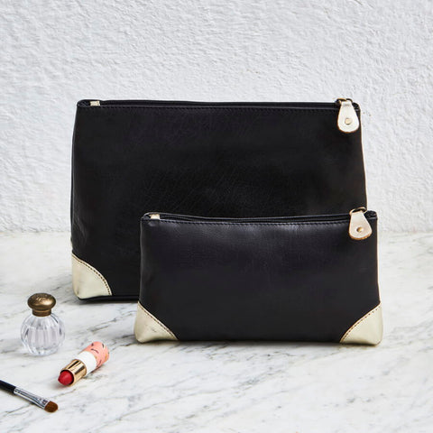 Matching leather wash bag and make up bag black and gold