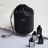 Black leather drawstring wash bag with initials and travel set
