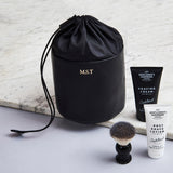 Black leather drawstring wash bag with initials