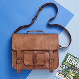 Styled view of tan leather special laptop bag