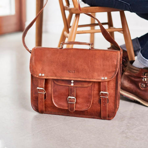 Personalised leather satchel in tan with front pocket and handle