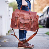 Man holing extra large weekend travel bag with gold initials embossed