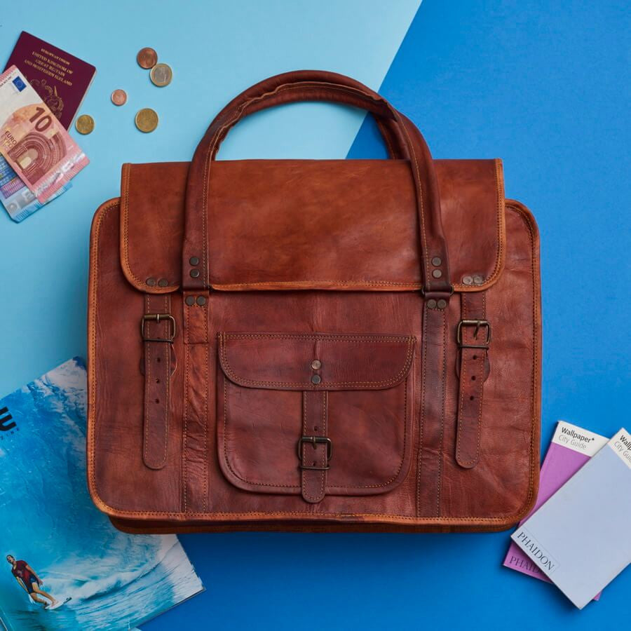 For Every Leather Travel Bag We Sell We Give a School Backpack. a18d8dcd2e