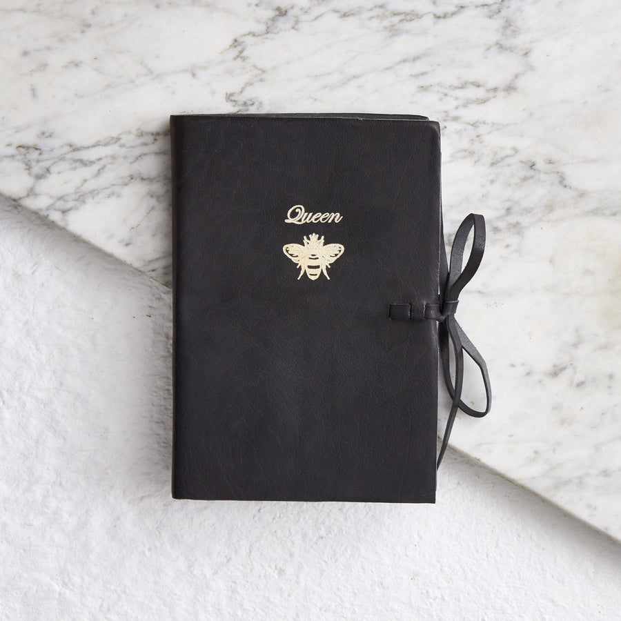 Black embossed leather notebook