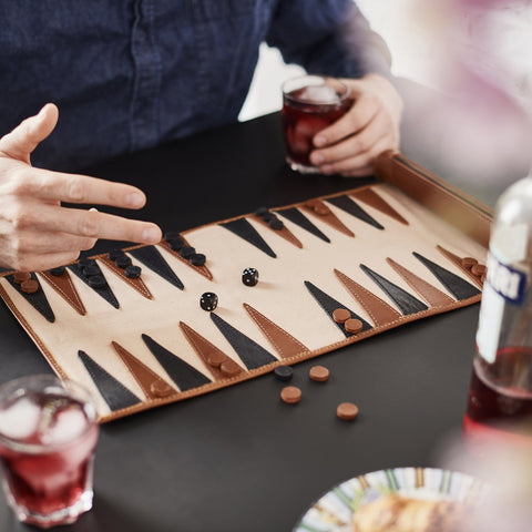 Travel backgammon set in dark tan leather