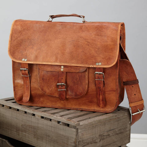 Satchel with front pocket and handle