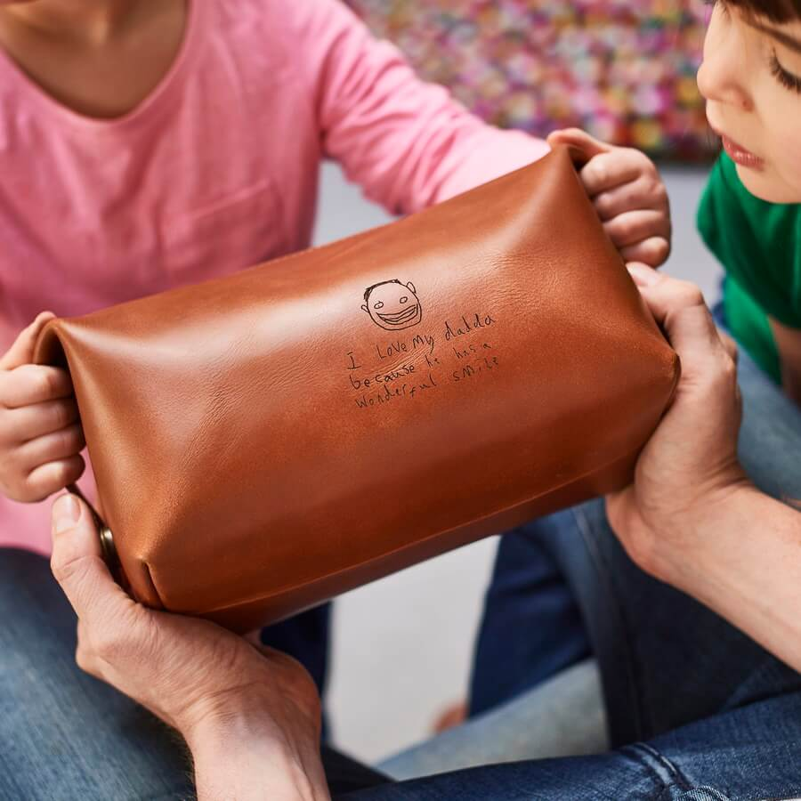 Leather washbag in tan brown with kids drawing laser engraved