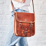 Gold embossed tan leather vintage style satchel