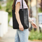 Vertical ladies tote bag in leather and canvas in black