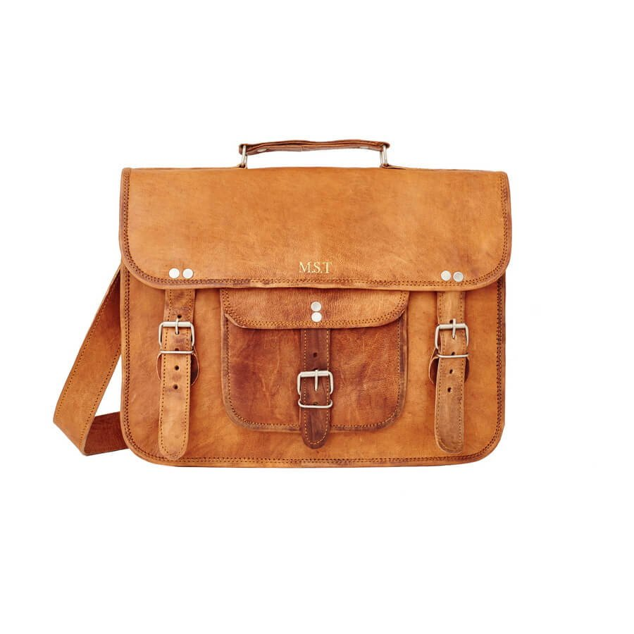 Satchel with front pocket and handle embossing position on front flap