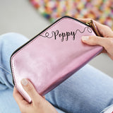 Metalic pink clutch bag with name