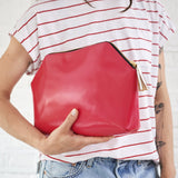 Pink leather clutch bag with personal message