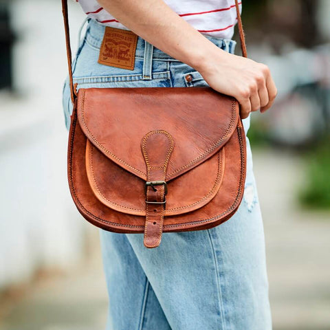 Ladies medium size leather shoulder saddle bag in tan