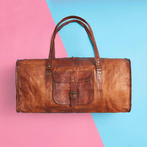 Large tan leather duffel bag