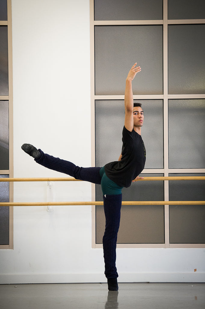 Desean Taber practicing at the barre in the studio at Boston Ballet