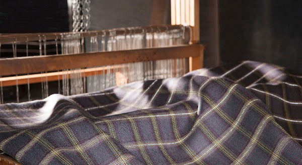 Dashing Tweeds Urban Check design draped across a table top loom