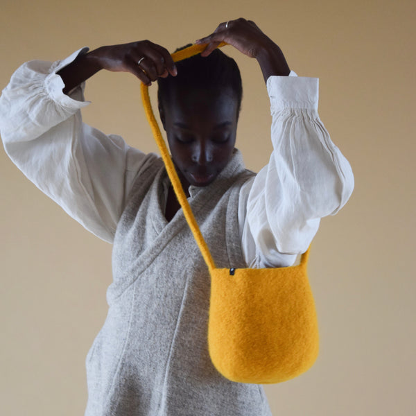 Burnt Amber Long Strap Smallest Bucket Bag by Cecilie Telle (NORWAY)