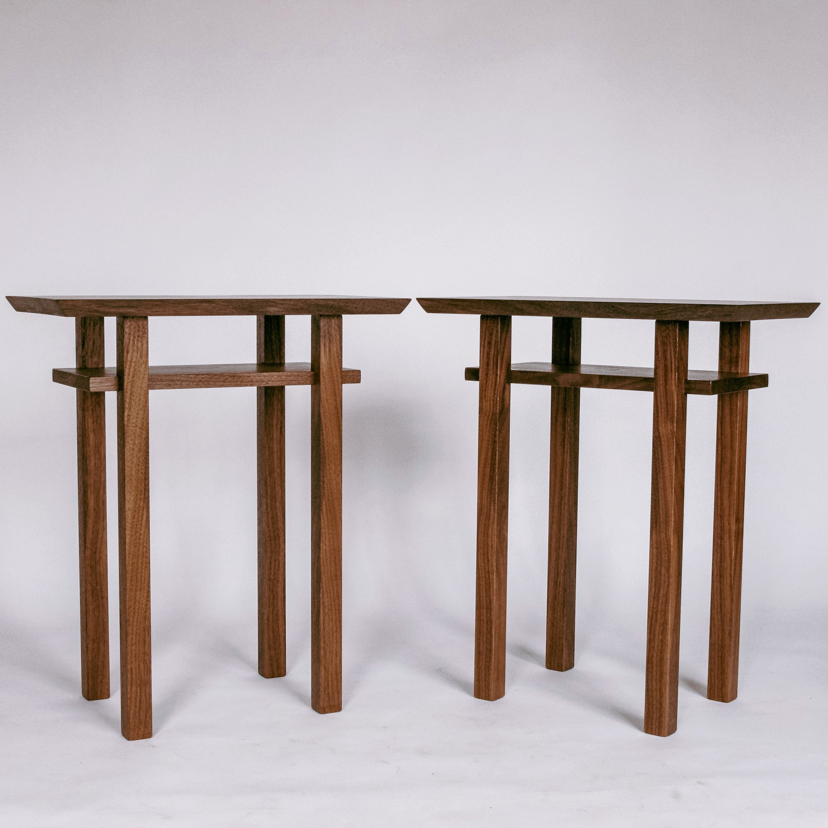 a pair of small end tables handmade from solid walnut