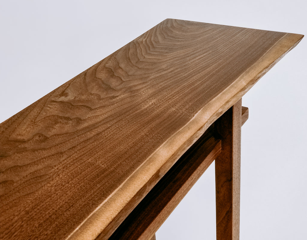 A live edge table in solid walnut- narrow side table or small console