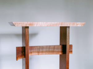 a modern wooden standing desk with live edge stretcher
