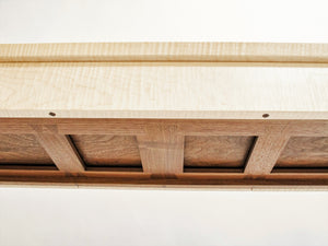 a uniquely designed web of interlocking dovetails support the narrow drawers at the top of our entry console table