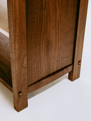 elegant curves balance the handsome lines of our walnut cabinet with drawers