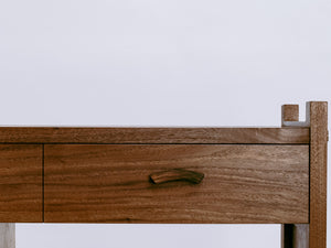 hand-shaped drawer pulls on our walnut sofa cabinet