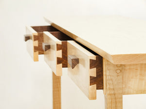 hand-cut dovetail joinery create these narrow wooded drawers on our entry console table
