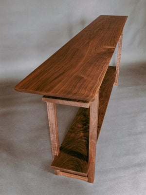 narrow wooden table handmade from solid walnut