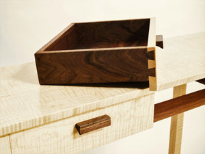 the narrow drawers of this custom console table are beautiful inside and out