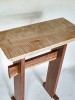 a tiger maple desk top and a dark walnut base are a beautiful contrast