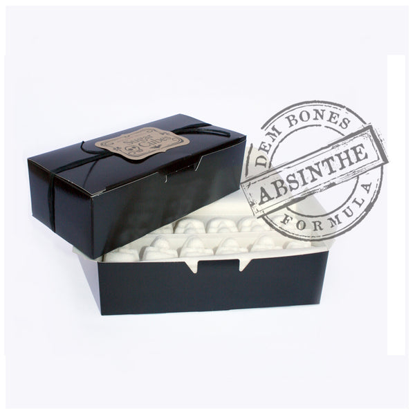 Stacked black boxes of Sugar Cube Skulls, DemBones Absinthe Formula Rubber stamp, white background