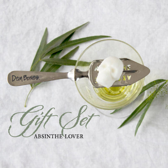 Absinthe Gift Set, Absinthe Glass, Skull Sugar Cube on Absinthe spoon, on white background with leaves