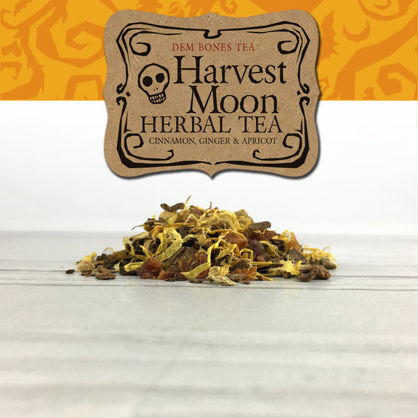 Herbal Tea in pile on white tile, Orange Spook Vine Graphics band with kraft label, DemBones Tea, Harvest Moon Herbal Tea, Cinnamon Ginger and Apricot, Halloween Gifts