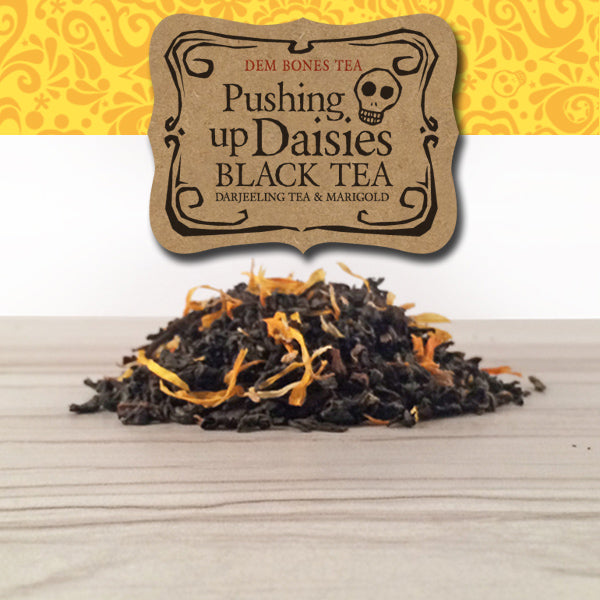 Pile of Tea on Tile background, Yellow graphics band with kraft label, Dem Bones Tea, Pushing Up Daisies, Black tea, Darjeeling Tea and Marigold,