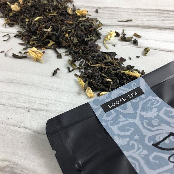 Jasmine tea spilling out of black bag, Loose Tea, Great graphics band with spooky vine, DemBones Shoppe Tea