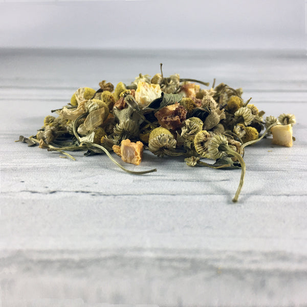 Close up of DemBones sleepy hallow herbal tea on white marble background close up of tea