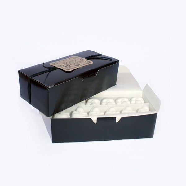 Stacked Black Candy Boxes, Skull Sugar Cubes in bottom box, white background