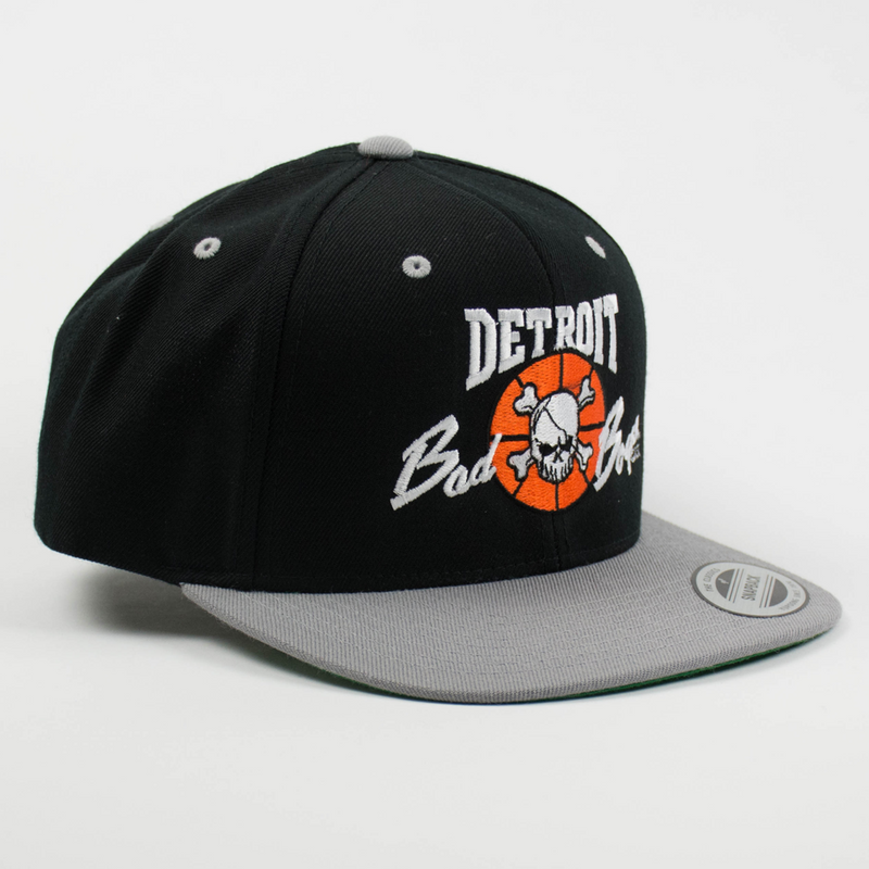 Officially Licensed Detroit Bad Boys Snap Back Hat - Black with Grey Bill (side view)