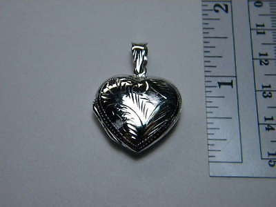 Locket Heart Sterling Silver .925% 1 inch Opens Closes holds 2 Pictures inside