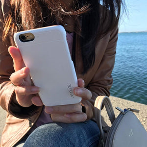 girl holding iphone 6 with sense wireless receiver case cosmic white