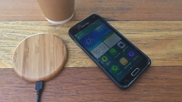 sense wireless golden bamboo charging pad on coffee table