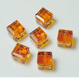 5601-4-to Swarovski Crystal 4mm Topaz Cube Beads (Package of 12 Beads)