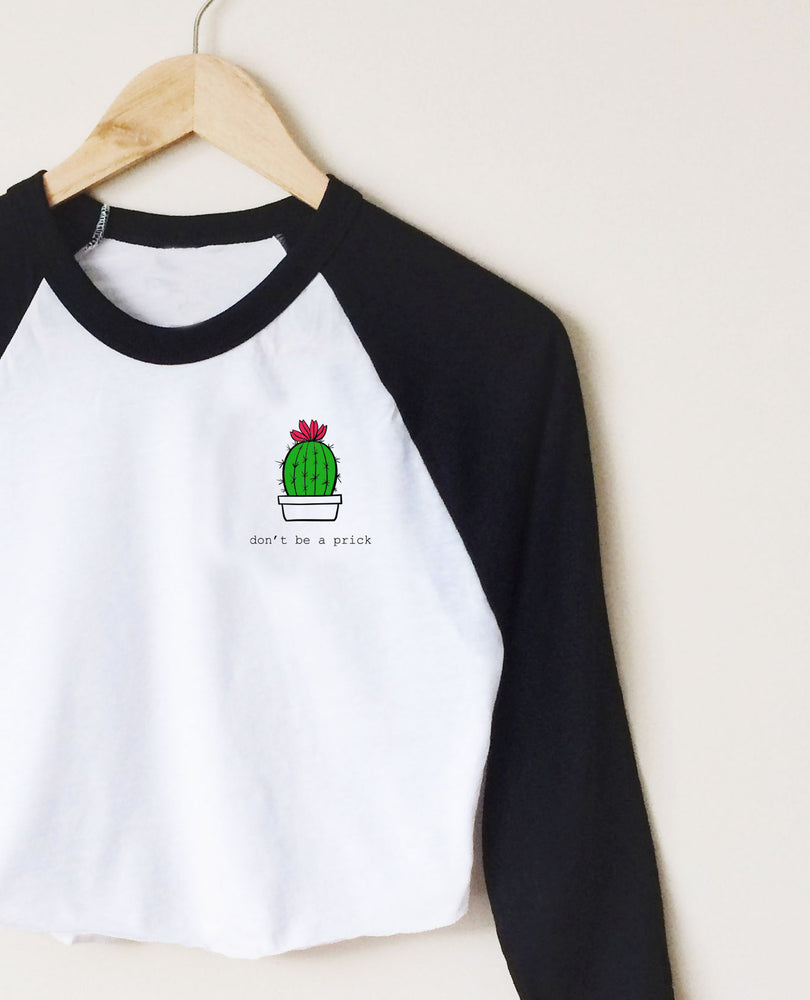 Don't Be A Prick! Cropped Raglan