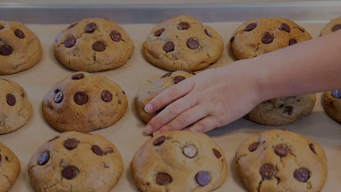 Happy person reaching out for cookie