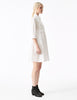 phaedra white cotton a-line button down shirt dress with fitted bodice and pockets side view