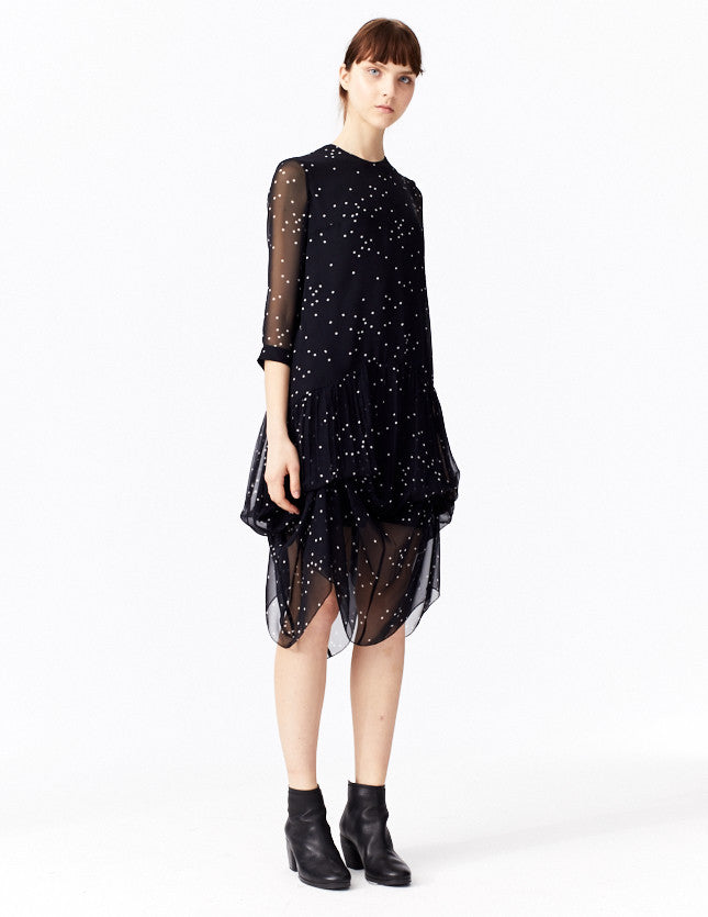 morgane le fay mid-length silk dress in signature star print with drop waist. made in new york.