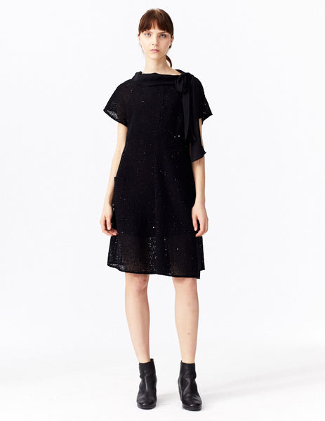 morgane le fay short, a-line dress with sequin detailing, rounded neckline, collar tie and side pockets. made in new york city.