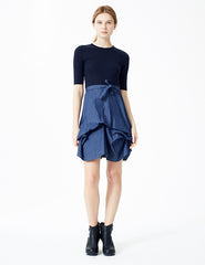 morgane le fay fitted dress with cotton jersey top and denim bustled skirt. tie at waist. made in new york