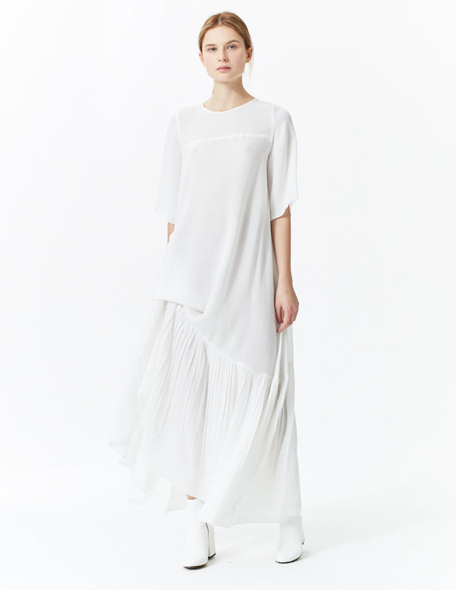 morgane le fay floor length silk dress with oversized, three-quarter sleeve and ruffle hem. made in new york.